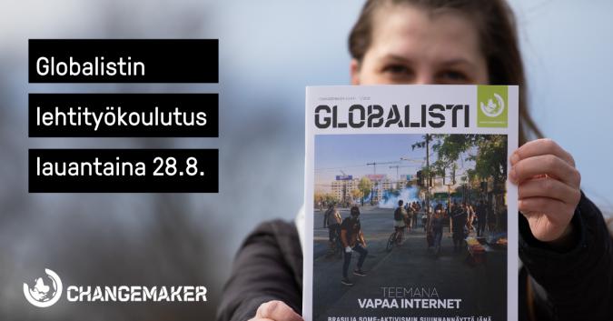 Kuvassa nainen pitää Globalisti-lehteä käsissään ja näyttää sitä kameralle.